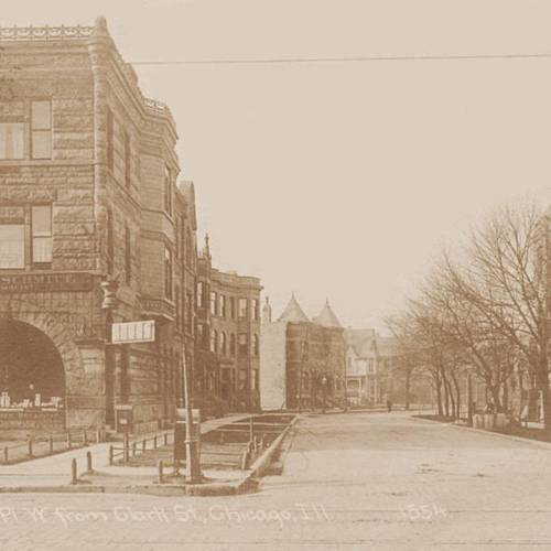postcard-chicago-arlington-place-w-from-clark-commercial-apartment-building-on-left-john-j-schmitt-pharmacy.jpg